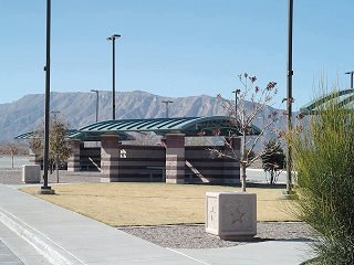 The curve roof form of these picnic arbors rhymes with the mountain backdrop