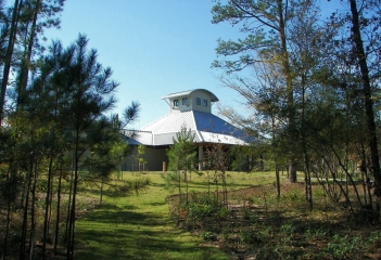 Another view of the facility through the pine trees