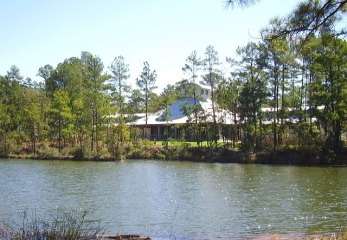 View of the Southbound facility across a water pond
