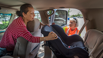 TxDOT employee performing a free safety seat check