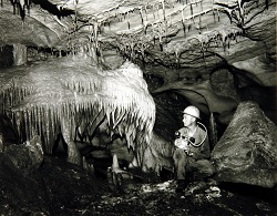 A Texas Highway Department employee exploring the Inner Space Caverns.