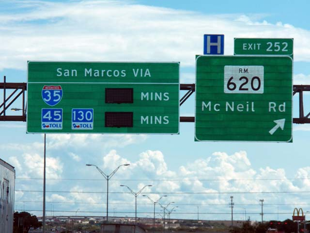 New signs along I-35 display travel times comparisons