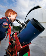 boyscout looking through telescope
